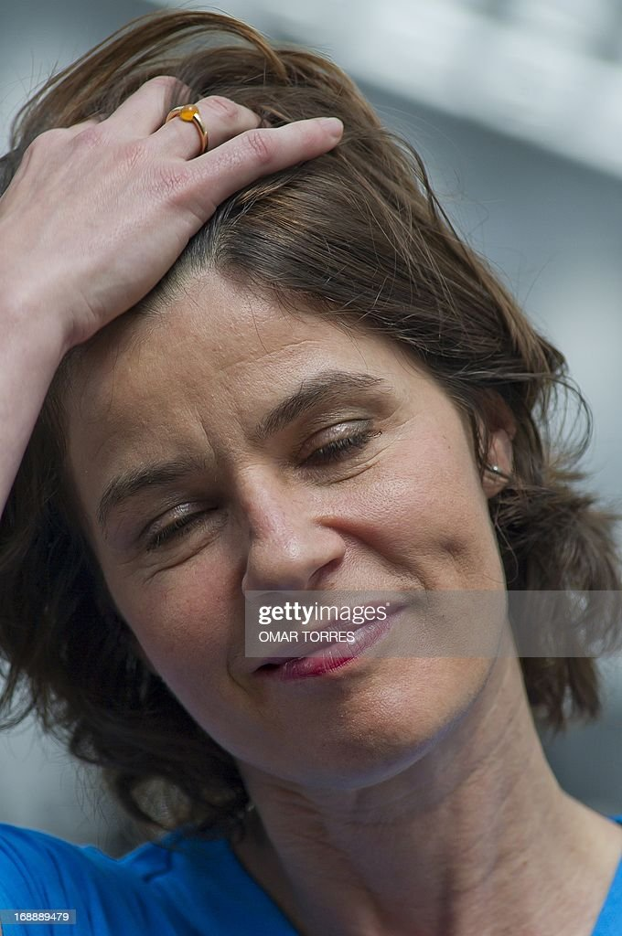 French-Swiss actress and singer Irene Jacob gestures prior a press conference in Mexico city on May 16, 2013. Jacob, who is known for her role in the film 'The Double Life of Veronique' will perform a concert with her brother Francis in Mexico on Friday 17.