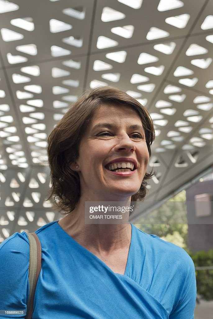 French-Swiss actress and singer Irene Jacob smiles prior a press conference in Mexico city on May 16, 2013. Jacob, who is known for her role in the film 'The Double Life of Veronique' will perform a concert with her brother Francis in Mexico on Friday 17.
