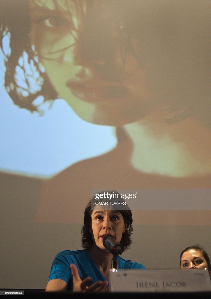 French-Swiss actress and singer Irene Jacob smiles speaks during a press conference in Mexico city on May 16, 2013. Jacob, who is known for her role in the film 'The Double Life of Veronique' will perform a concert with her brother Francis in Mexico on Friday 17.