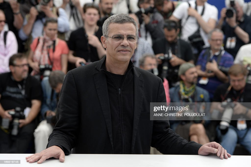 French-Tunisian director Abdellatif Kechiche poses on May 23, 2013 during a photocall for the film 'Blue is the Warmest Colour' (La Vie d'Adele - Chapitre 1 & 2) presented in Competition at the 66th edition of the Cannes Film Festival in Cannes. Cannes, one of the world's top film festivals, opened on May 15 and will climax on May 26 with awards selected by a jury headed this year by Hollywood legend Steven Spielberg.
