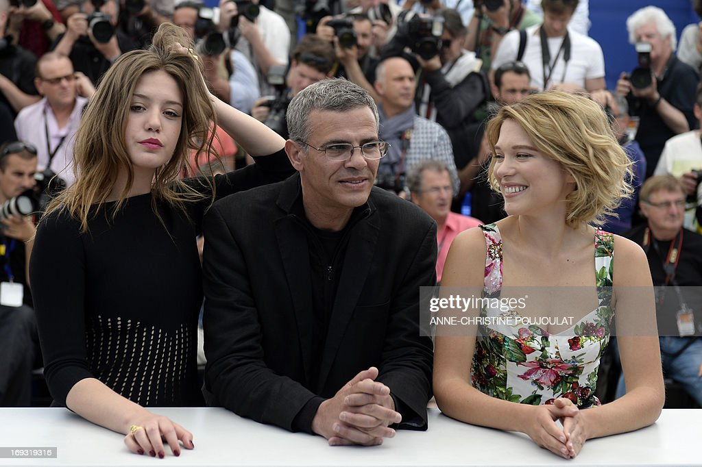 French-Tunisian director Abdellatif Kechiche (C) poses on May 23, 2013 with French actresses Adele Exarchopoulos (L) and Lea Seydoux during a photocall for the film 'Blue is the Warmest Colour' (La Vie d'Adele - Chapitre 1 & 2)presented in Competition at the 66th edition of the Cannes Film Festival in Cannes. Cannes, one of the world's top film festivals, opened on May 15 and will climax on May 26 with awards selected by a jury headed this year by Hollywood legend Steven Spielberg. AFP PHOTO / ANNE-CHRISTINE POUJOULAT