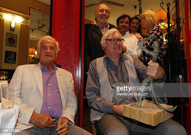 FrenchUS singersongwriter David McNeil receives from French actor JeanPaul Belmondo the 'Prix du Singe' a prize awarded for talent and vagabond...