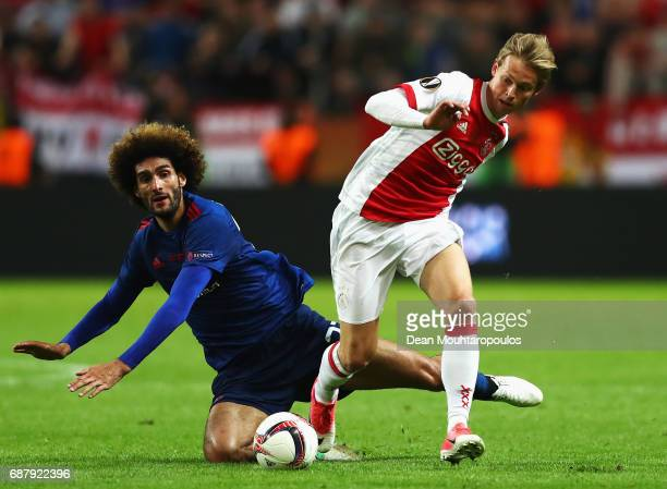 Frenkie de Jong of Ajax gets past Marouane Fellaini of Manchester United during the UEFA Europa League Final between Ajax and Manchester United at...