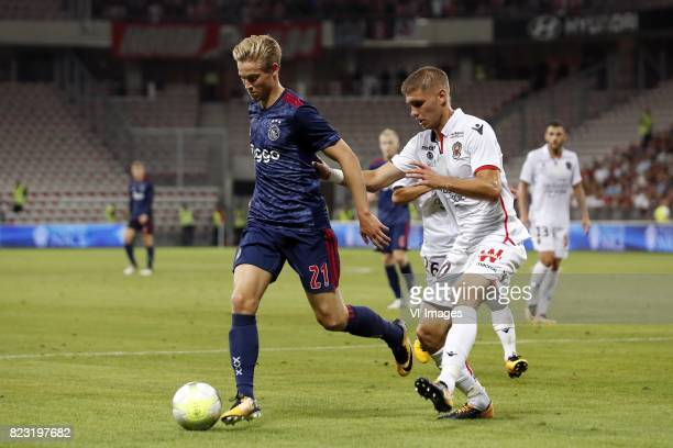 Frenkie de Jong of Ajax Maxime Le Marchand of OCG Nice during the UEFA Champions League third round qualifying first leg match between OGC Nice and...