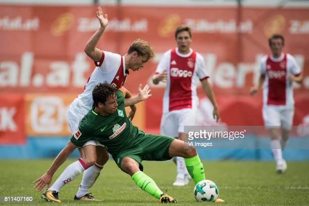 Frenkie de Jong of Ajax Thomas Delaney of SV Werder Bremen during the friendly match between Ajax Amsterdam and SV Werder Bremen at Lindenstadion on...