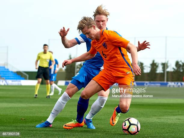 Frenkie De Jong of Netherlands competes for the ball with Fredrik Jensen of Finland during the international friendly match between Netherlands U21...