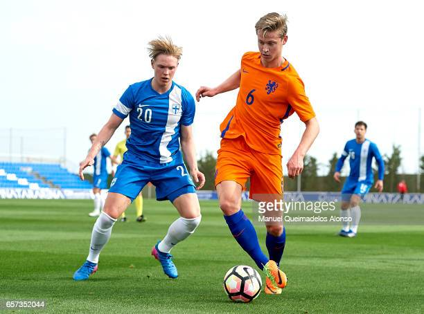Frenkie De Jong of Netherlands is closed down by Fredrik Jensen of Finland during the international friendly match between Netherlands U21 and...