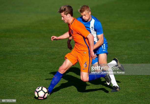 Frenkie De Jong of Netherlands is closed down by Mikko Kuningas of Finland during the international friendly match between Netherlands U21 and...
