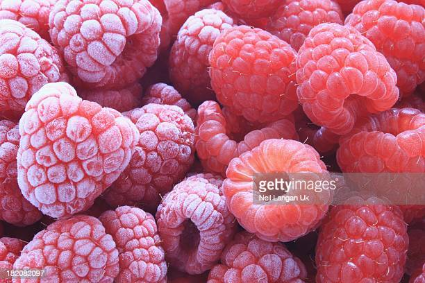 fresh and frozen raspberries close up