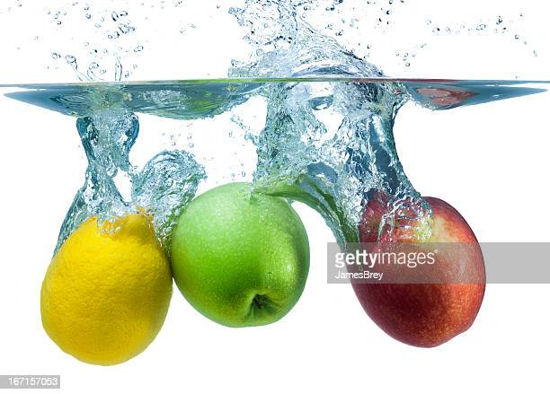 Fresh Apples and Lemon Splash Into Cool Water