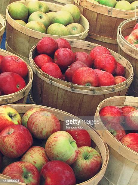 Fresh apples in wood baskets