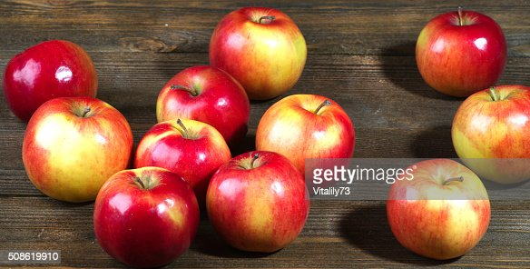 fresh apples on a wooden table in the background : Stock Photo