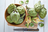 Fresh artichokes on the table of the kitchen to be cooked