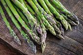 fresh asparagus on a wooden table