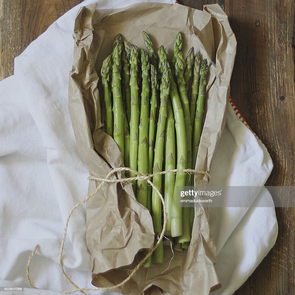 Fresh asparagus wrapped in paper