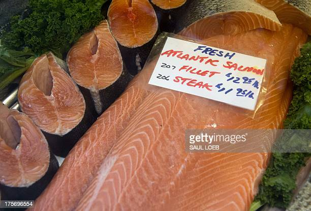 Fresh Atlantic salmon steaks and fillets are displayed for sale at Eastern Market in Washington DC August 6 2013 The market located on Capitol Hill...