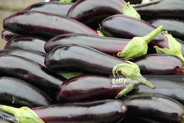 fresh aubergines on the market