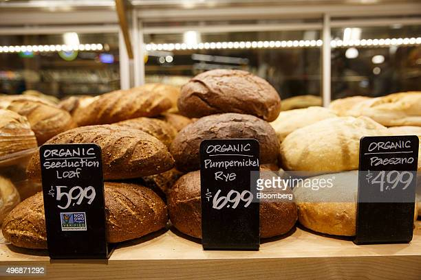 Fresh baked loaves of bread are displayed for sale at the new Whole Foods Market Inc store in downtown Los Angeles California US on Monday Nov 9 2015...