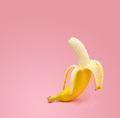 Fresh banana on pink background