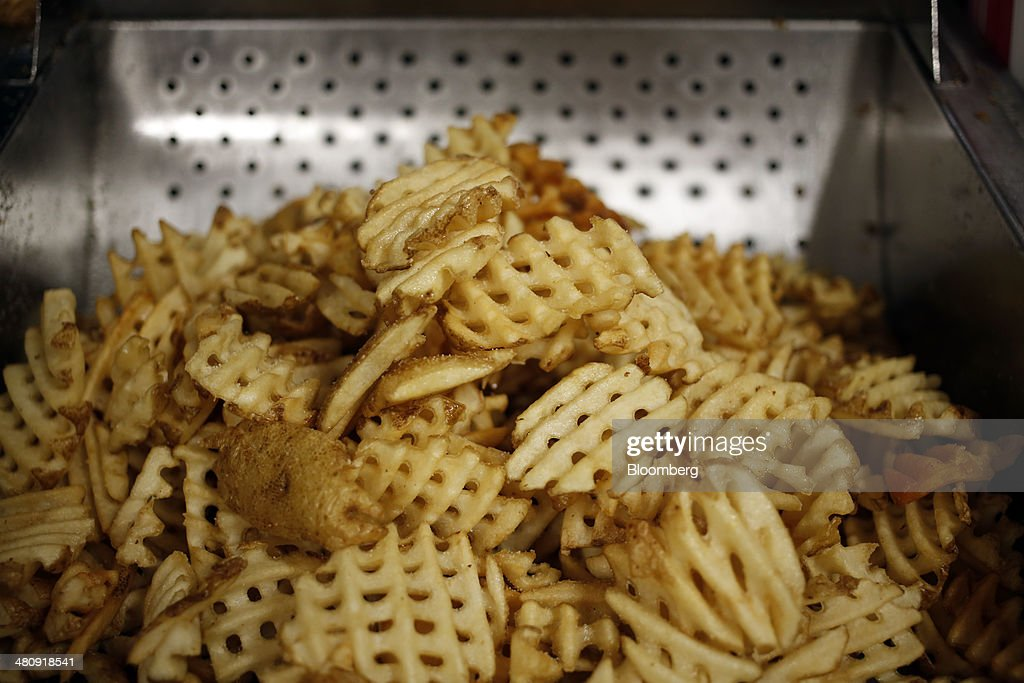 A fresh batch of waffle fries sit before being served at a Chick-fil-A Inc. restaurant in Bowling Green, Kentucky, U.S., on Tuesday, Mar. 25, 2014. The U.S. economy grew more rapidly in the fourth quarter than previously estimated as consumer spending climbed by the most in three years, showing the expansion had momentum heading into this years harsh winter. Photographer: Luke Sharrett/Bloomberg via Getty Images
