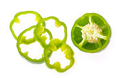 Fresh bell pepper with sliced parts isolated on white background