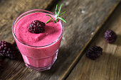 Fresh blackberry smoothies in a glass
