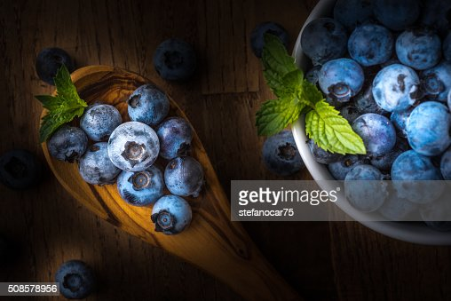 fresh blueberry on a wooden table and bowl : Stock Photo