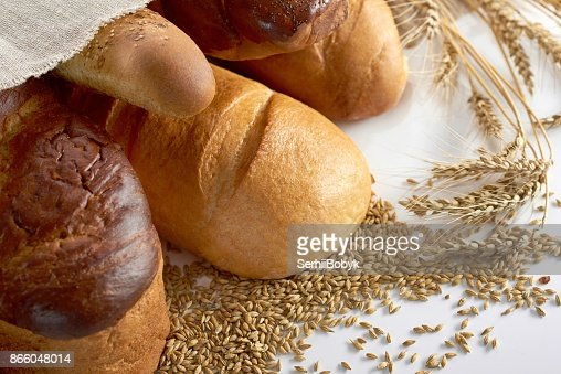 Fresh bread on wooden worktop : Stock Photo
