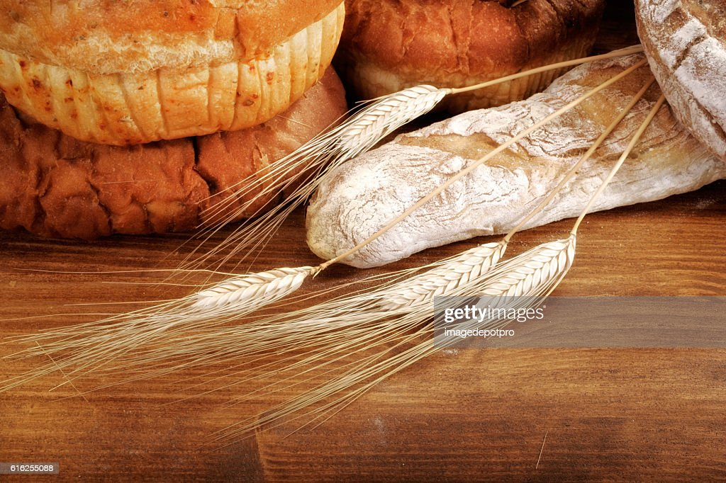 fresh breads and wheat : Stock Photo
