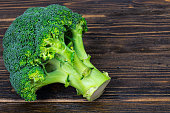 Fresh broccoli on wooden background. Studio Photo