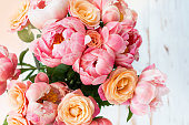 Fresh bunch of pink peonies and roses. Card Concept, pastel colors, close up image