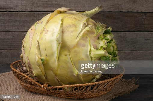 fresh cabbage kohlrabi on a dark wooden background : Stock Photo
