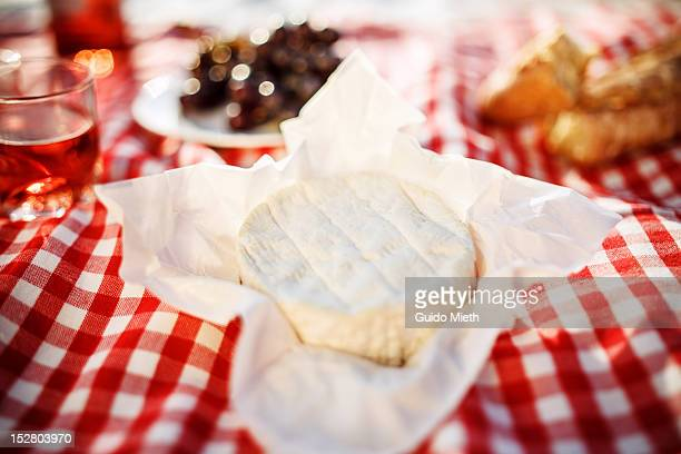 Fresh camembert, bread and rose