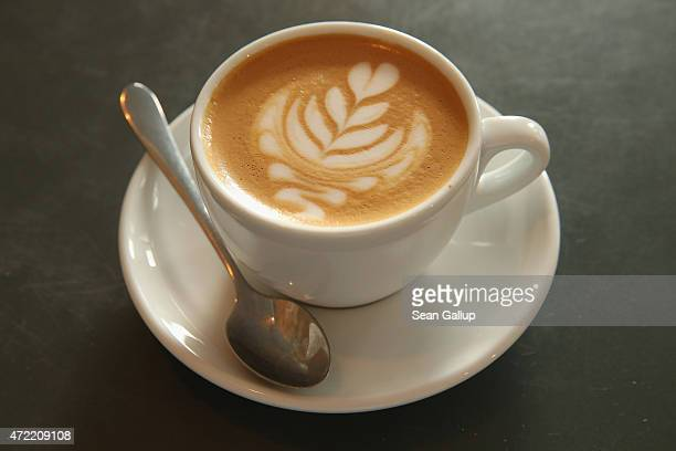 A fresh cappuccino sits on a table at Bonanza Coffee cafe in Prenzlauer Berg district on May 4 2015 in Berlin Germany Berlin is among Europe's most...