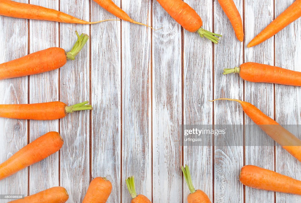 Fresh carrot on wooden background : Stock Photo