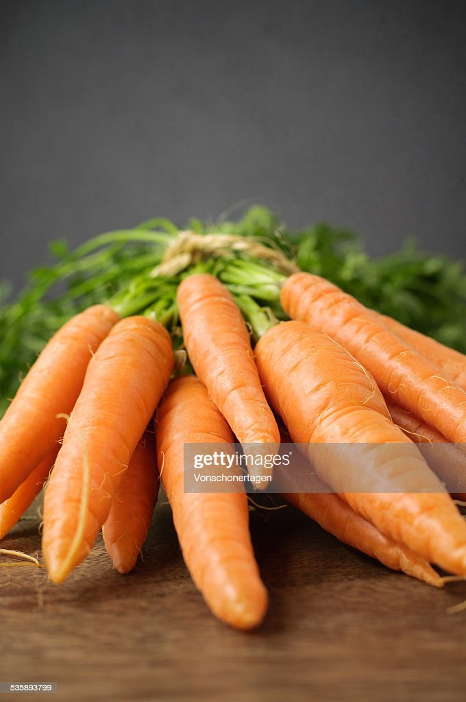 Fresh carrots on wooden table : Stock Photo