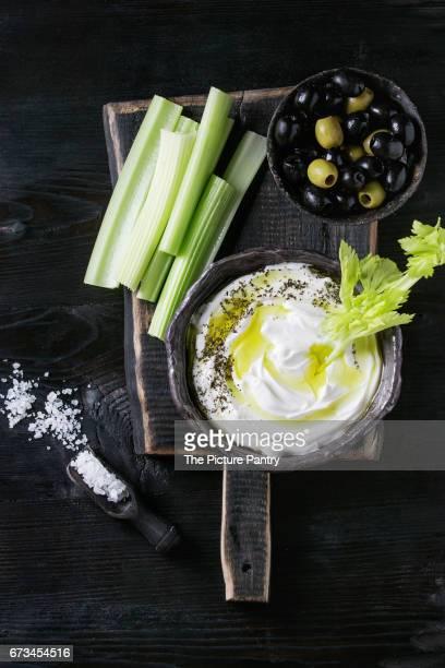 Fresh celery with yogurt dip