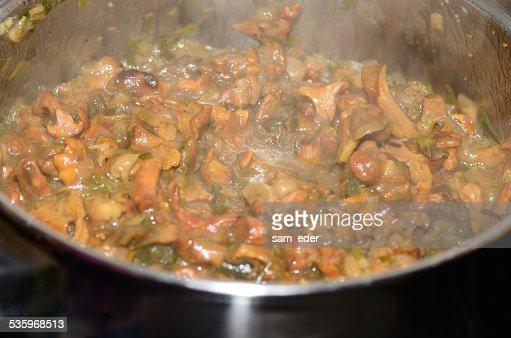 fresh chanterelle mushrooms cooking : Stock Photo
