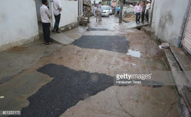 Fresh charcoal patchwork done on street leading to a dalit's home in Sushilpura slum where BJP National President Amit Shah visited for the lunch on...