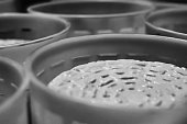 Closeup view of cheese draining pot set. Black and white