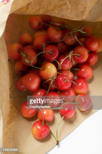 Fresh cherries in paper bag : Stock Photo