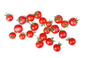 Fresh cherry tomatoes with green stem isolated on white background. Top view.