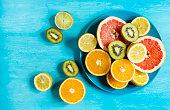 citrus fruit cut half on a blue table top view