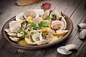 Fresh Cockle clams (Venus, Meretrix) with wine sauce. Portuguese dish.