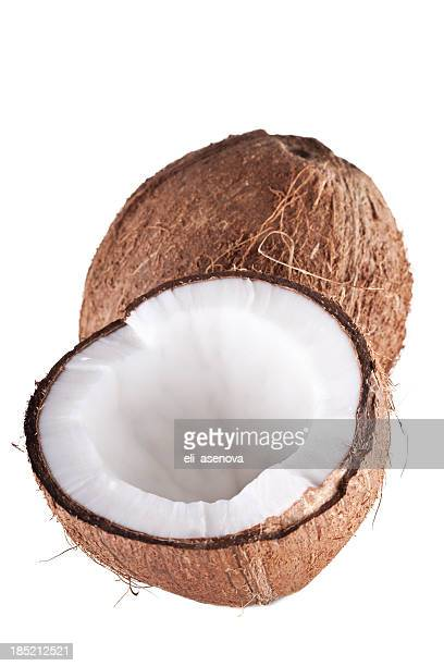A fresh coconut cut in half on a white background