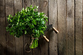 Fresh Colorful Vibrant Parsley with Knife on Wooden Table. Summer, Spring, Healthy Life or Detox Concept.