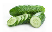 Fresh cucumber, chopped cucumber with pieces, isolated on white.