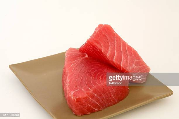 Fresh cut Ahi on a square tan plate ready to cook
