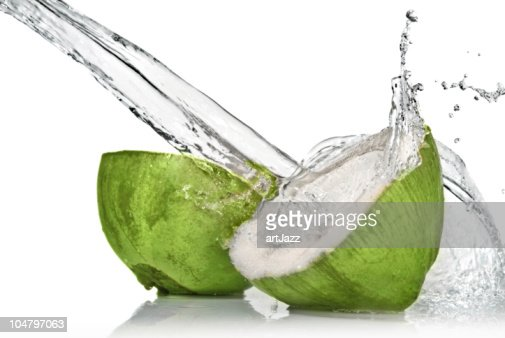 fresh cut green coconut with water splash on white : Stock Photo