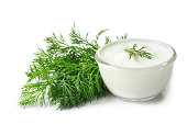 fresh dill and sour cream on a white background